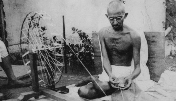 mahatma gandhi with charkha